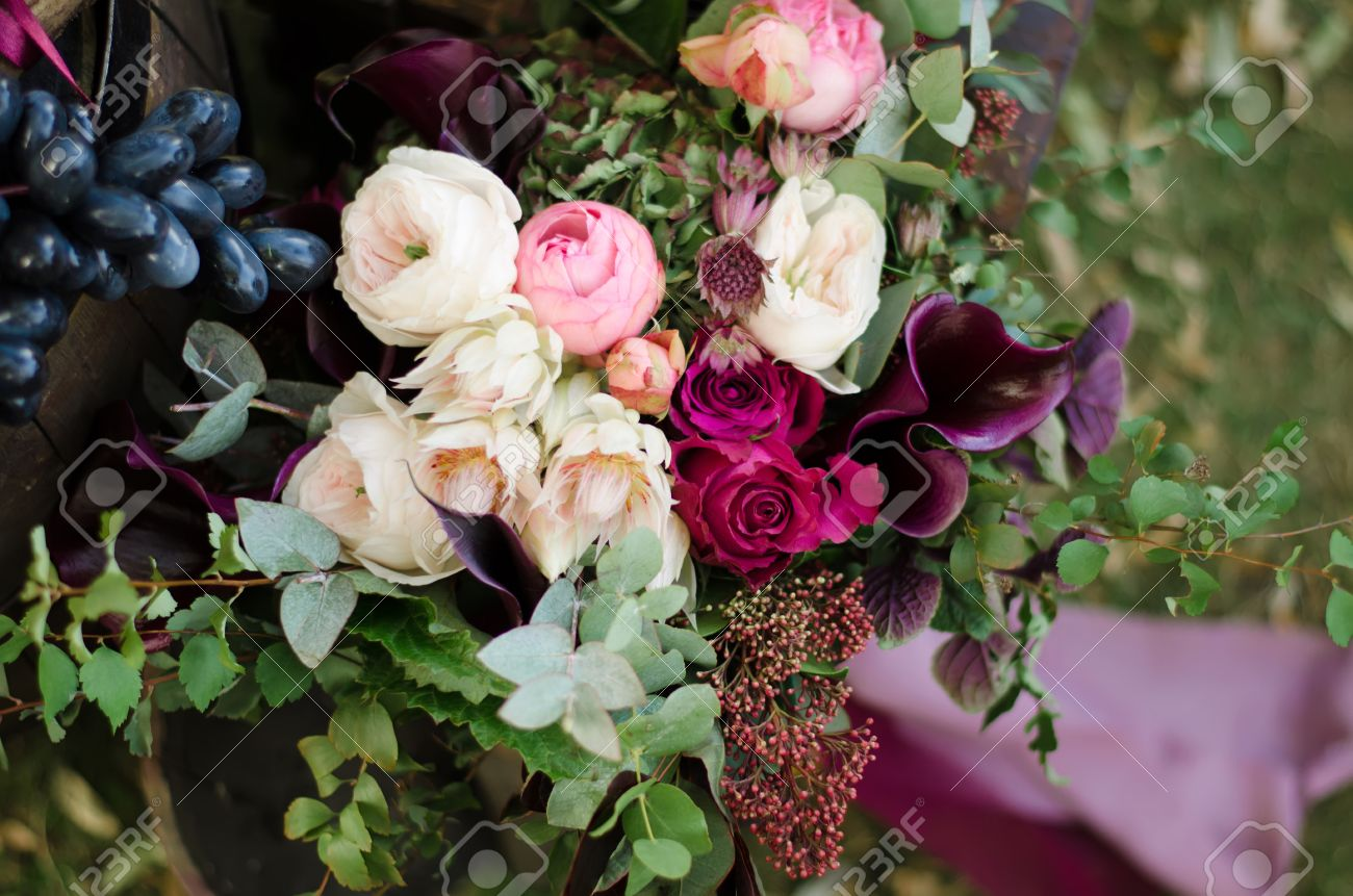 Beautiful Wedding Boho Bouquet Of Red And Pink Flowers And Greens Stock Photo Picture And Royalty Free Image Image 47658967
