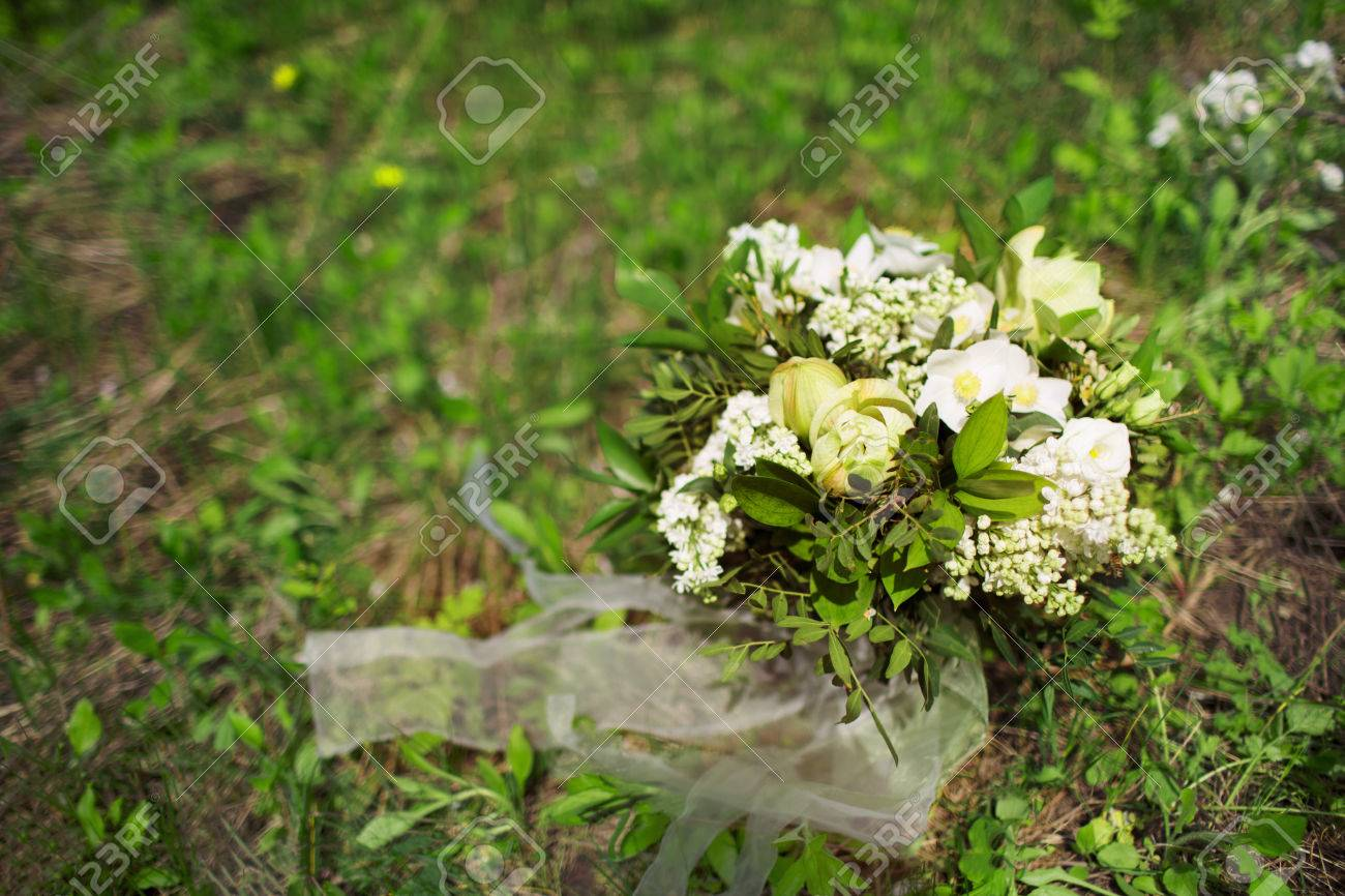 Wedding bouquet of white flowers on the grass bridal bouquet stock stock photo wedding bouquet of white flowers on the grass bridal bouquet izmirmasajfo