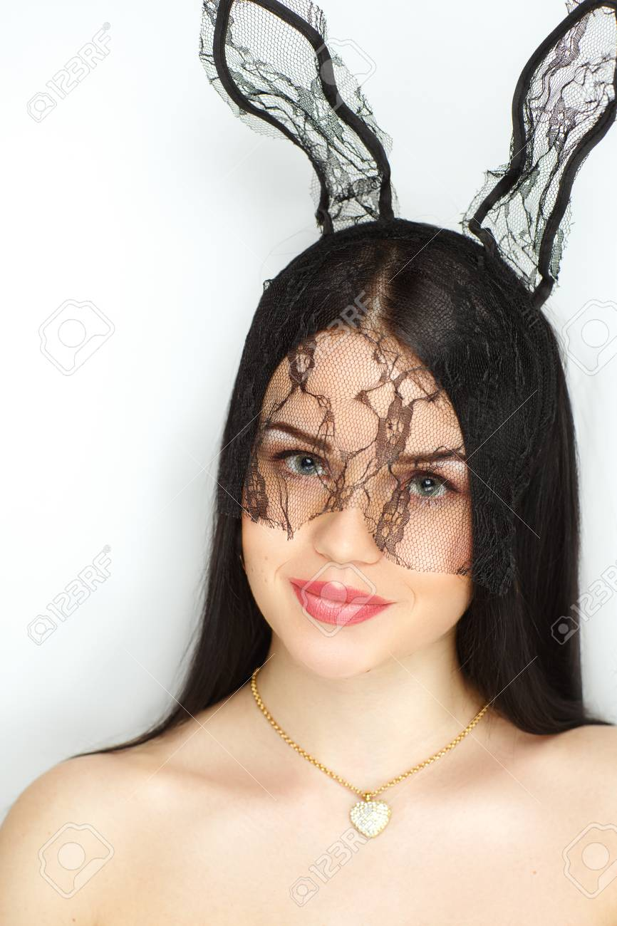 The girl in a transparent lace mask with funny bunny ears, sexy play boy  show. Young beautiful lady with fashionable hairdo and professional makeup.  perfect ...