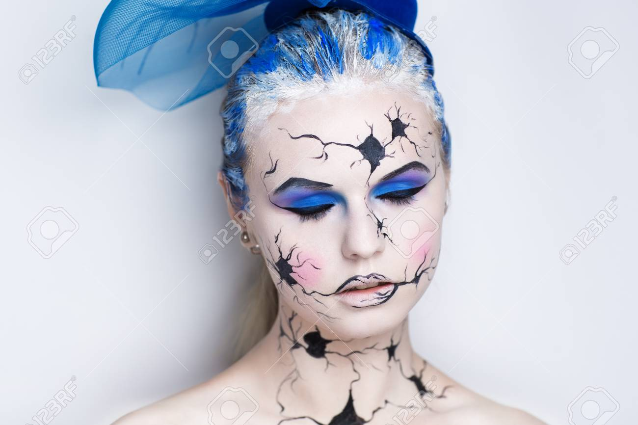 Art make up vintage porcelain doll with broken face black cracked