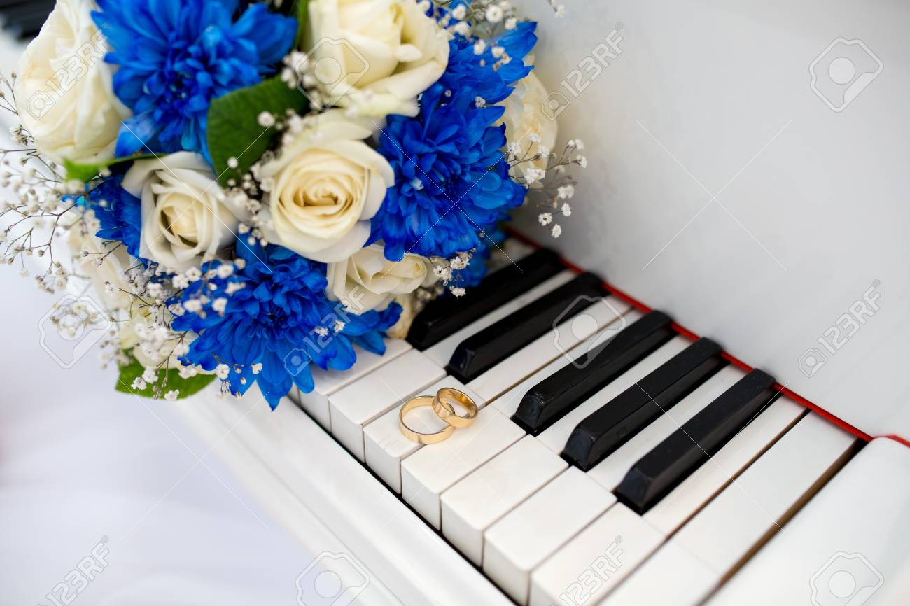 Big white black piano keys and two wedding rings flower bouquet big white black piano keys and two wedding rings flower bouquet composition of cream blue izmirmasajfo Image collections