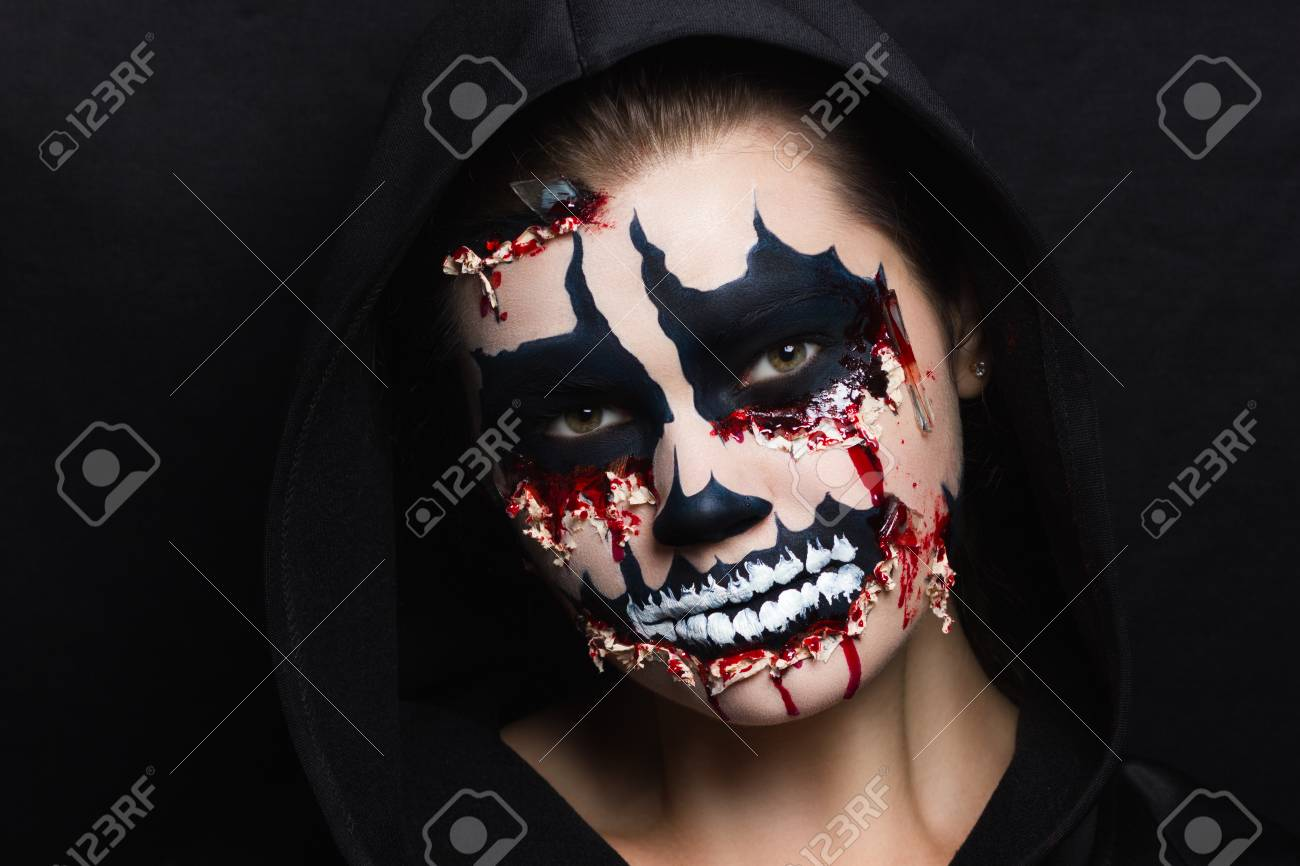 woman monster. Creative dark make-up, conceptual idea for Halloween. Eerie nightmare turning into a black vampire, volume spikes body art painting. Professional photo darkness background horizontal - 94575287