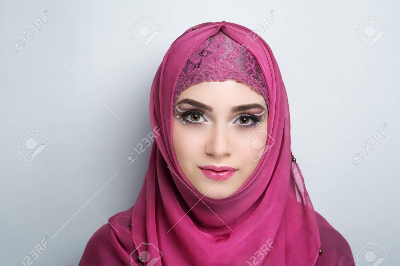 Young beautiful woman (lady girl) headscarf hijab. Professional cosmetics  bright makeup. Shiny