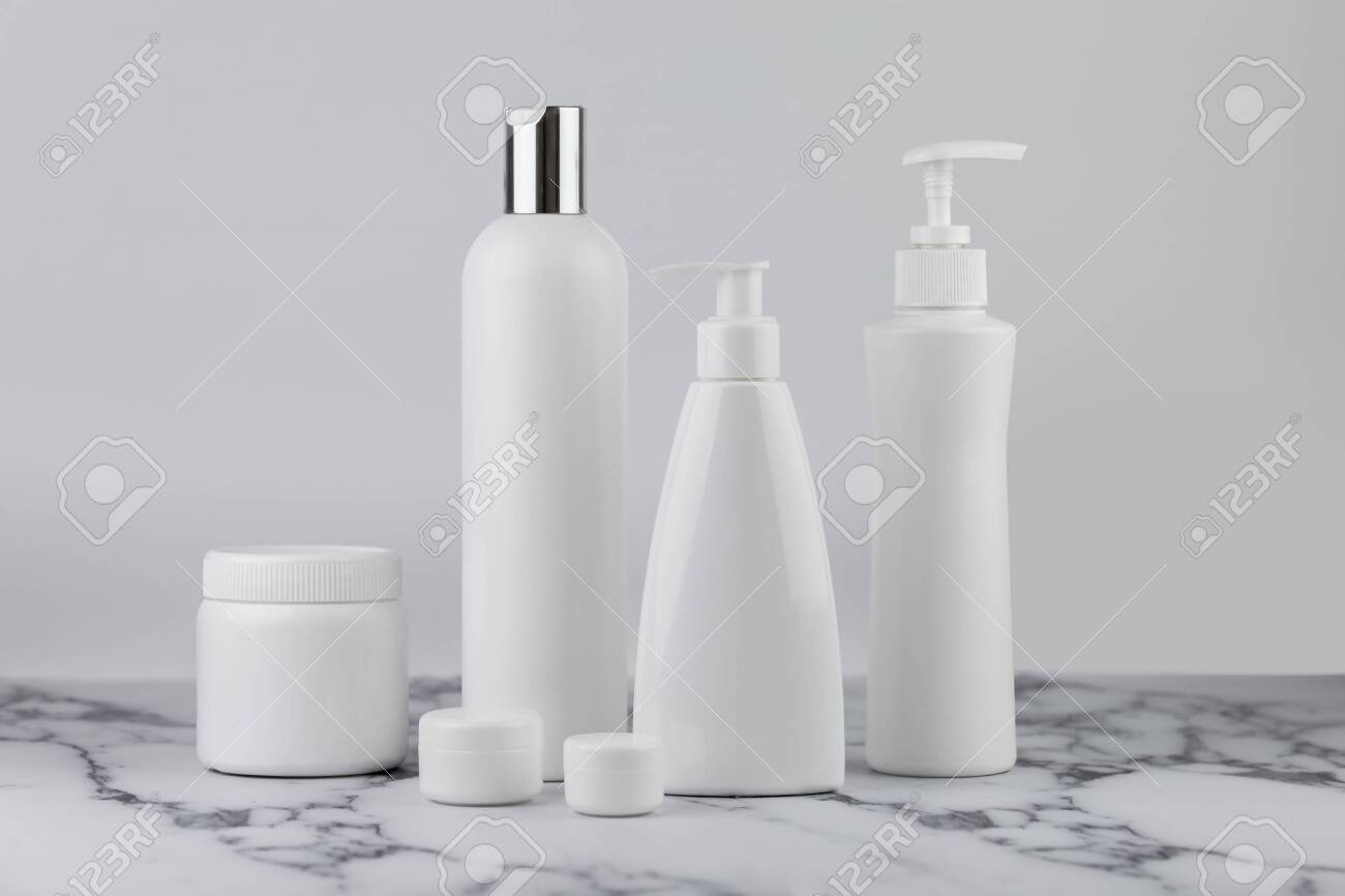 Set of cosmetic bottles, collection empty white bottles of cream with dispenser, shampoo or lotion on white background. - 131989847