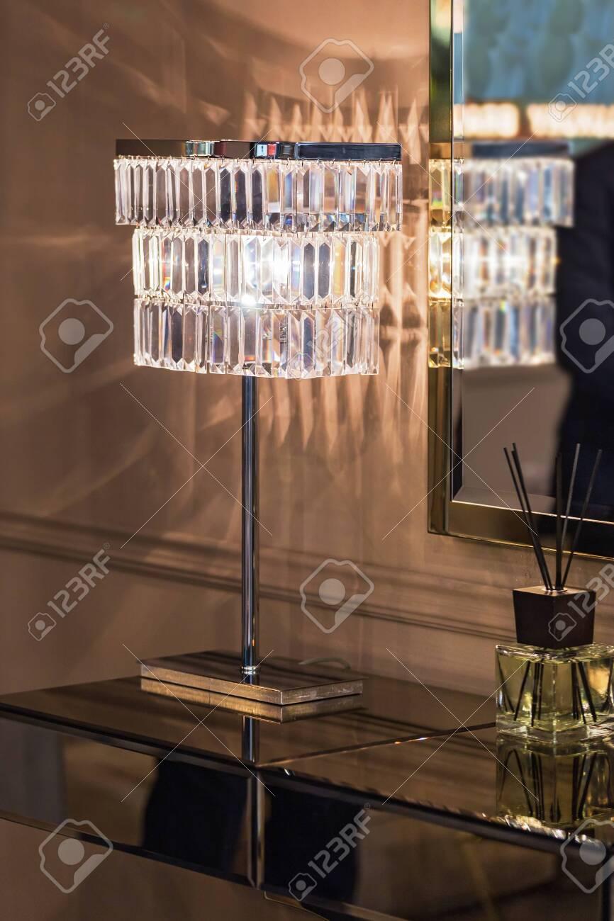 Classic Crystal Reading Lamp On Bedside Table In Cozy Gold Bedroom Interior Fotos Retratos Imagenes Y Fotografia De Archivo Libres De Derecho Image 142027174
