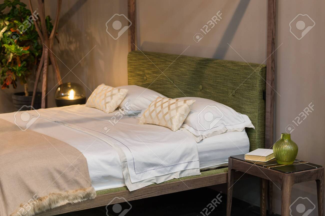 Double Bed Bedroom With Wooden Elements Marble And Wood Bedside Stock Photo Picture And Royalty Free Image Image 141850242