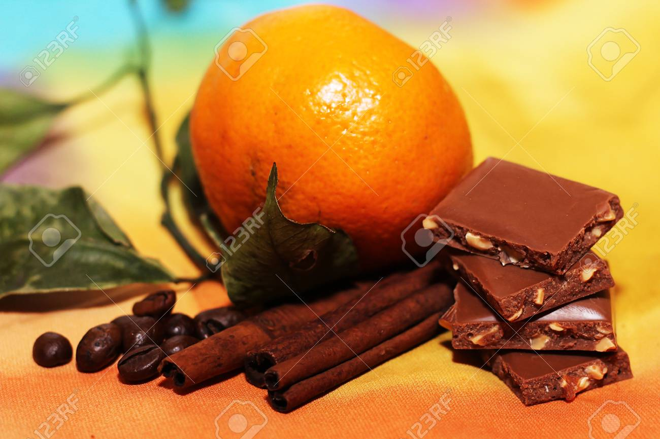 orange and cinnamon sweet dark chocolates happy new year stock photo 70794619