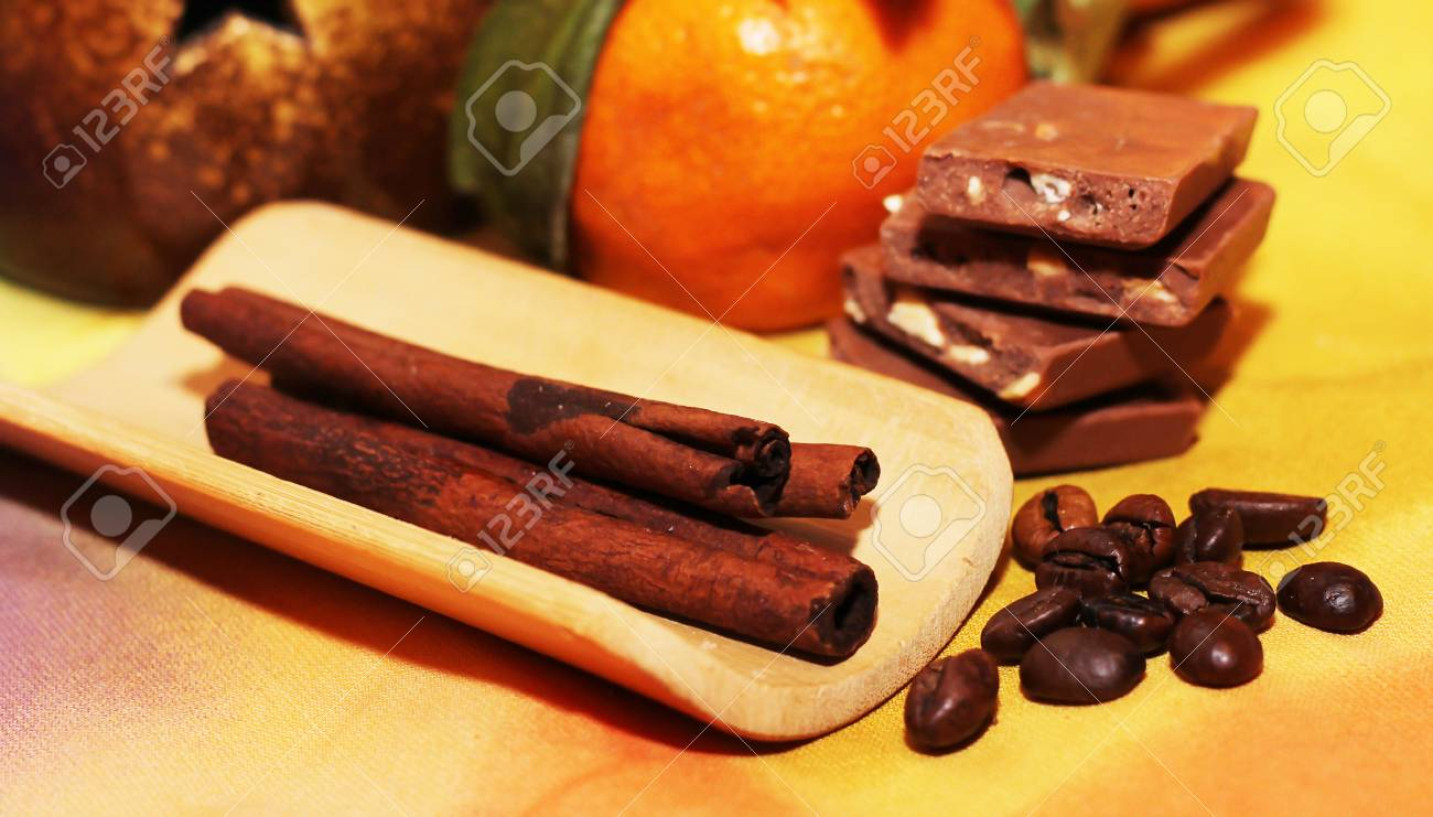 orange and cinnamon sweet dark chocolates happy new year stock photo 70765420