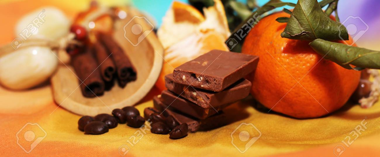 orange and cinnamon sweet dark chocolates happy new year stock photo 70815861
