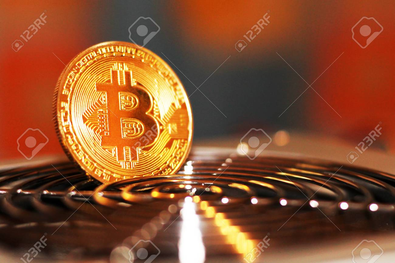 Golden Bitcoin virtual currency on a circuit board background,