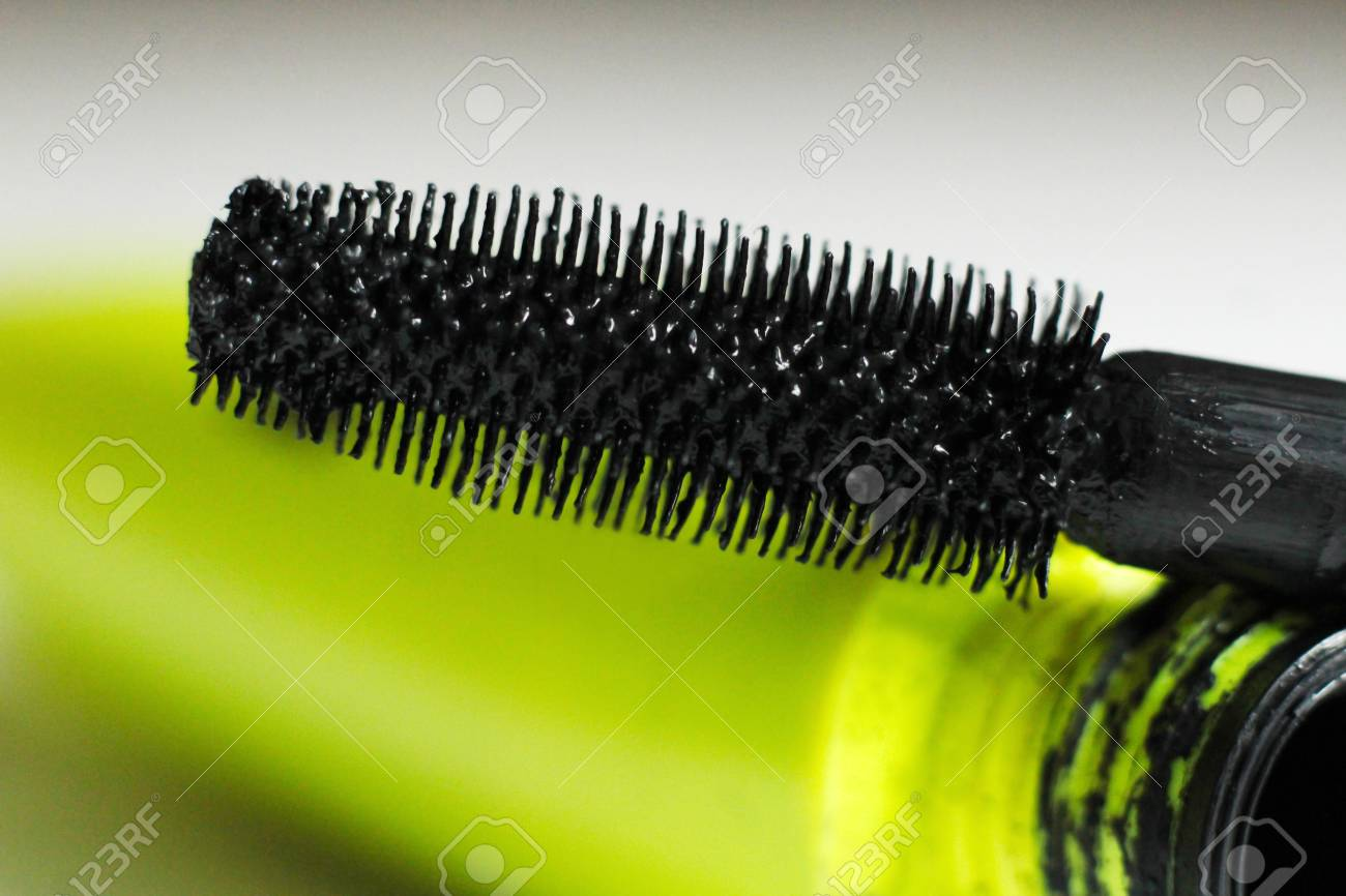 ab94413d576 Black Mascara Brush Stroke And Yellow Tube Stock Photo, Picture And ...