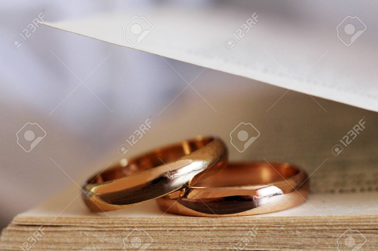 Two wedding rings and a book so close, object - 122019015
