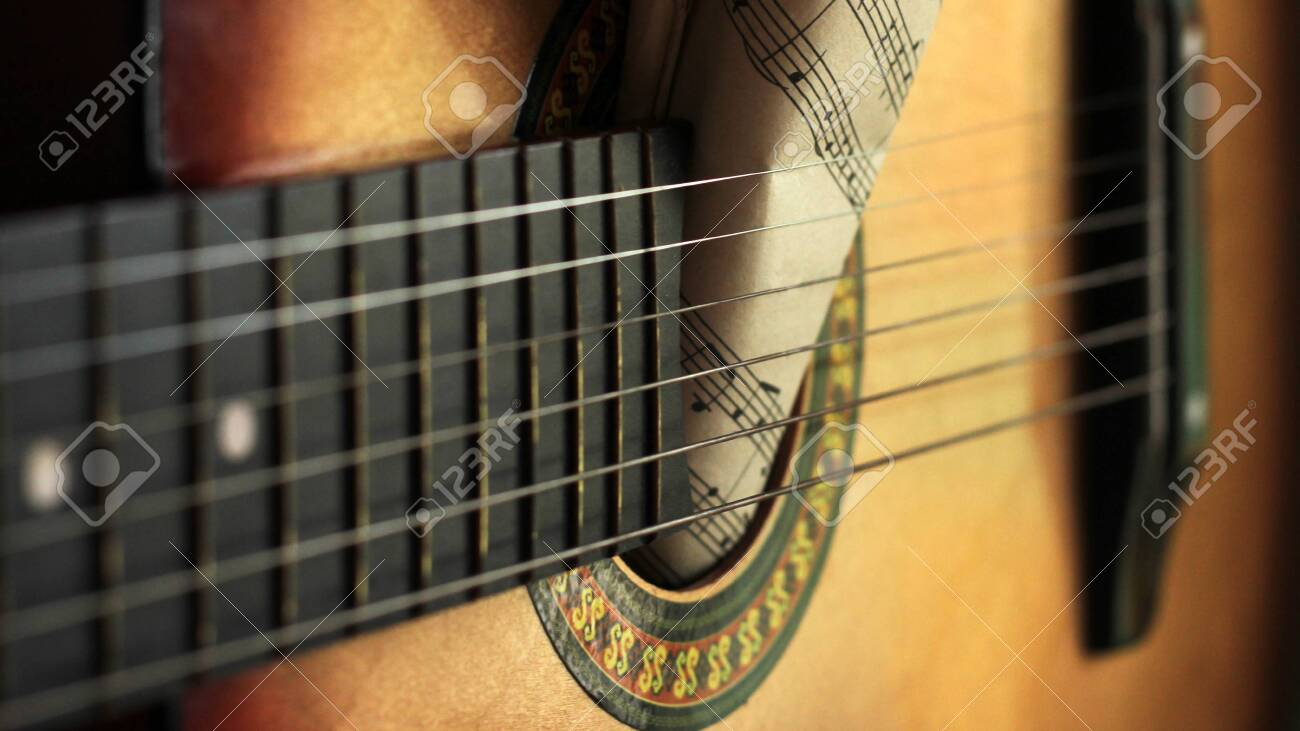 Guitar strings and torn paper notes, music idea - 130904489