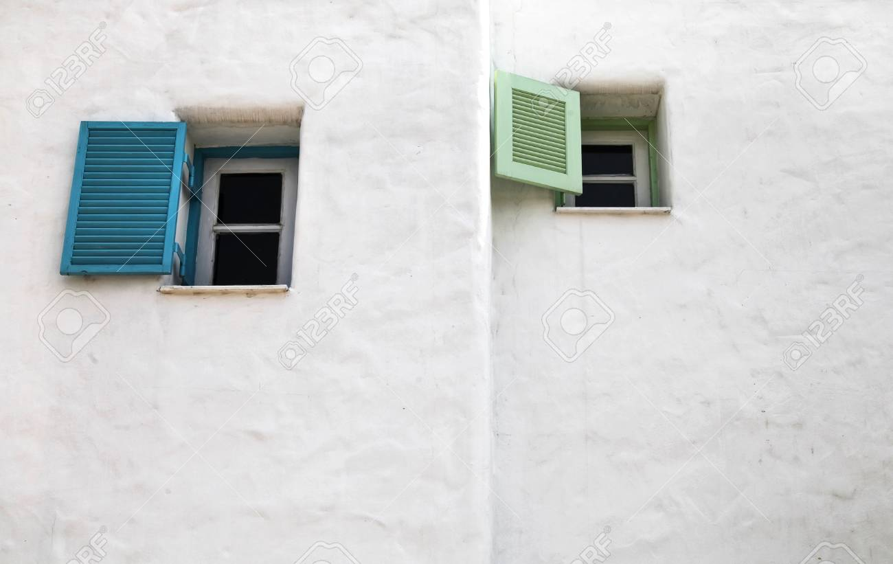 Two open greek windows on the old wall Stock Photo - 18309854