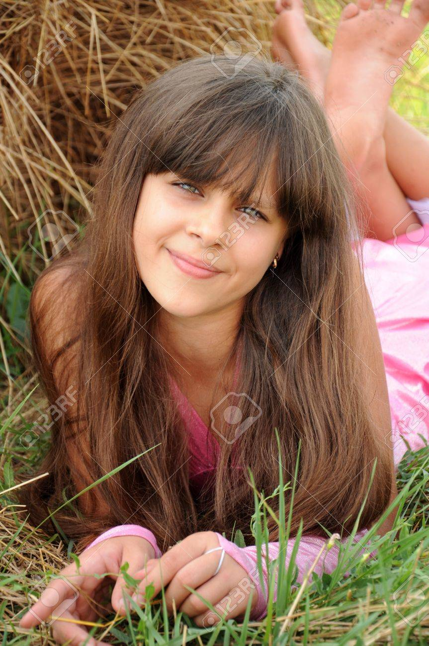 Beautiful girl in a field on a background of straw Stock Photo - 10213434