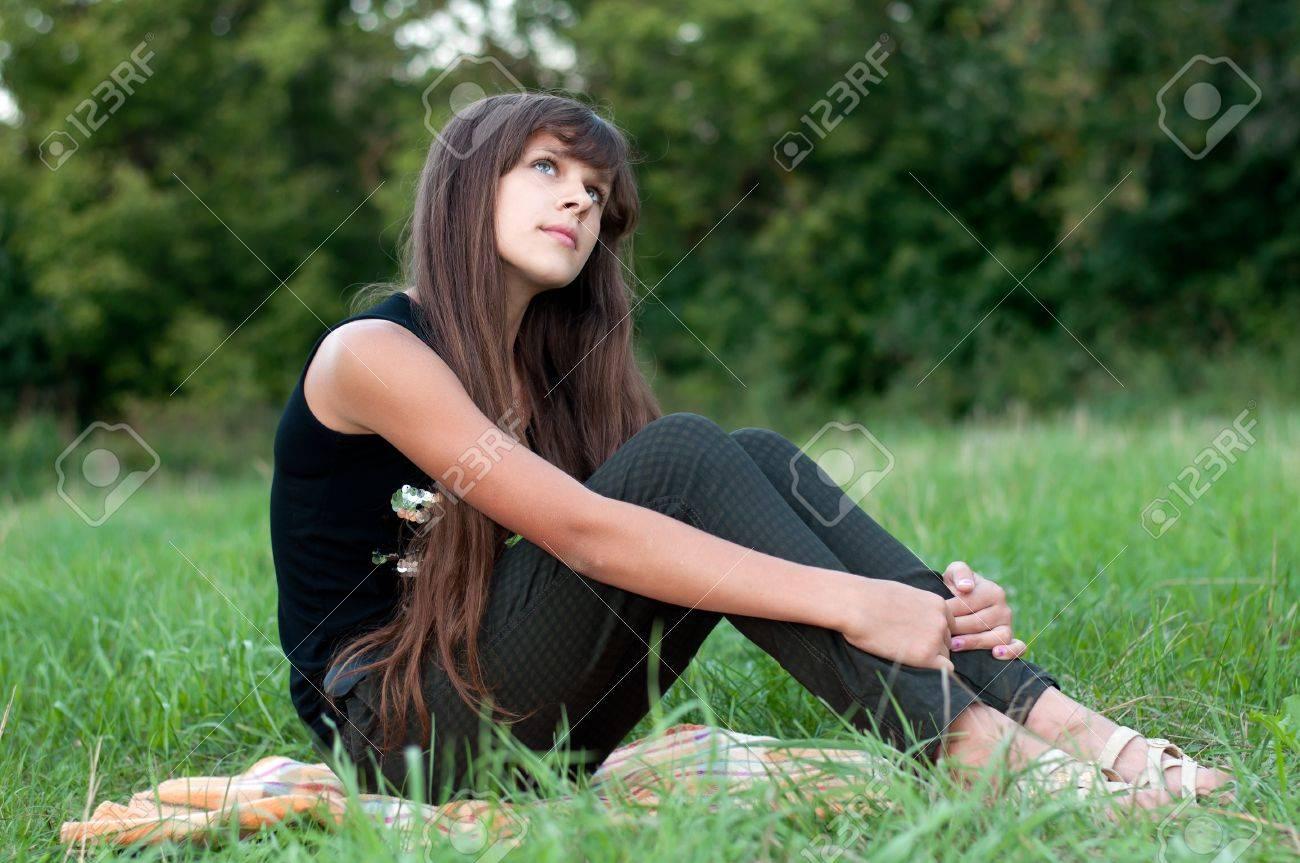 Brunette teen girl on nature Stock Photo - 15542928