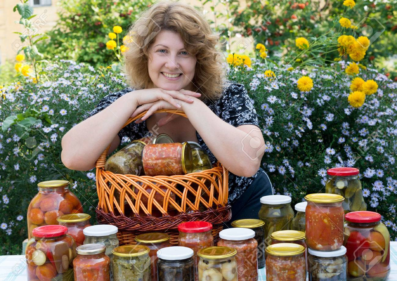 Woman with home canning for the winter - 22349376