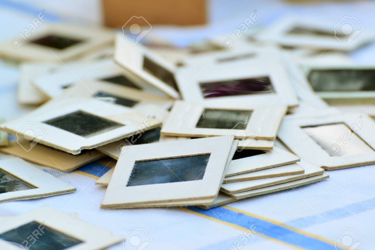 many old slides on the table in the garden stock photo picture and