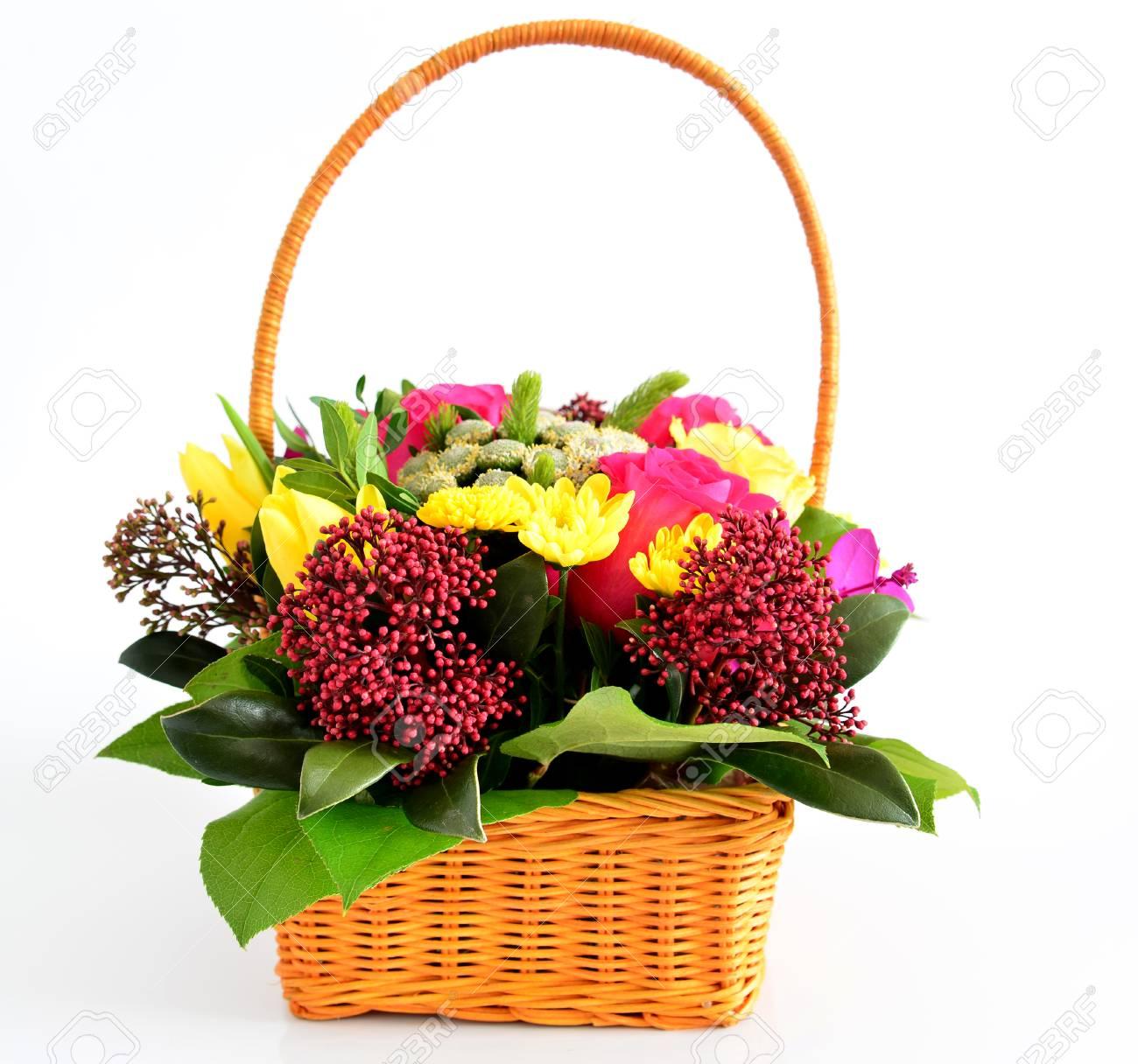 Beautiful flowers in a wicker basket on a light background stock beautiful flowers in a wicker basket on a light background stock photo 54743239 izmirmasajfo