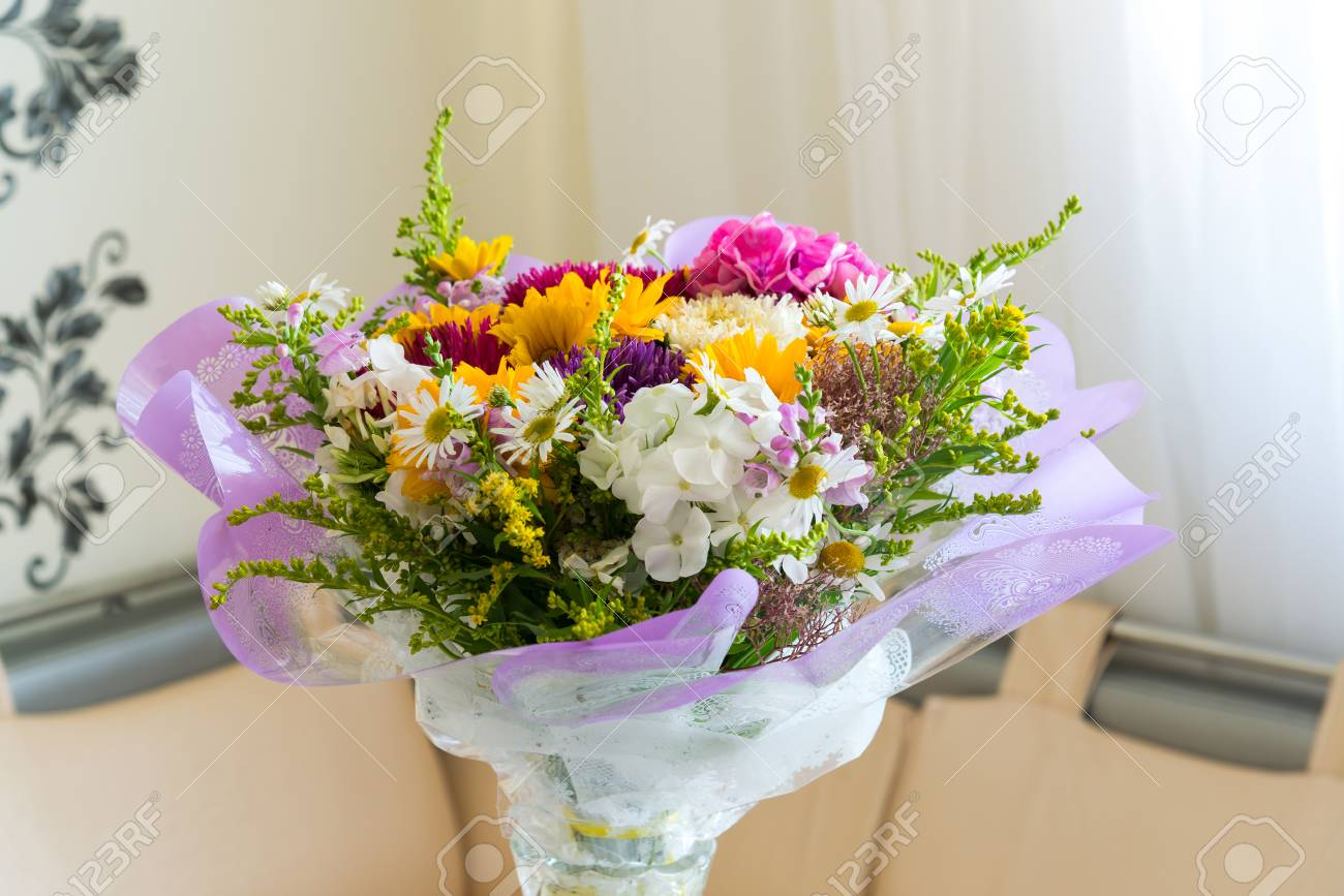 Bouquet Of Flowers On The Table In The Room Stock Photo Picture And