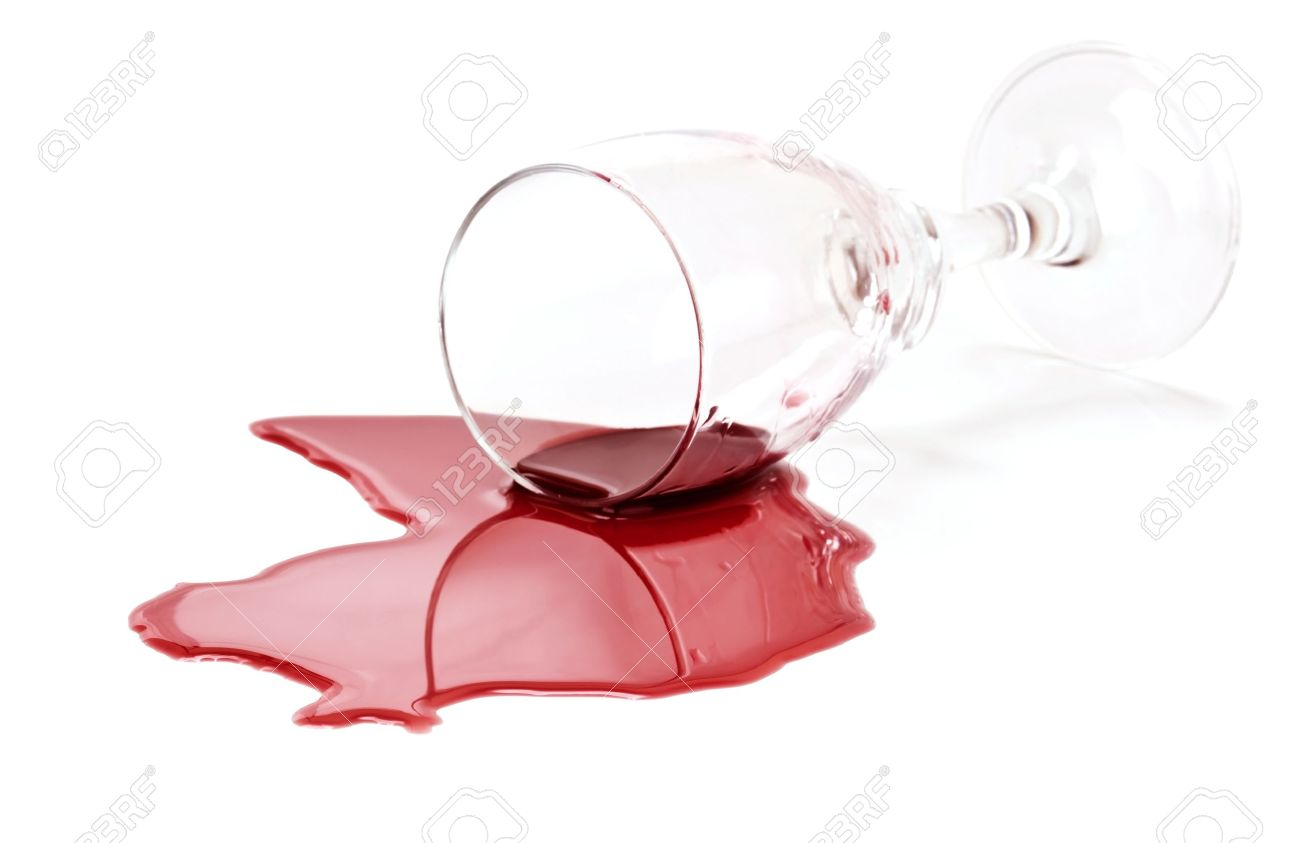 spilled red wine glass isolated on white background stock photo
