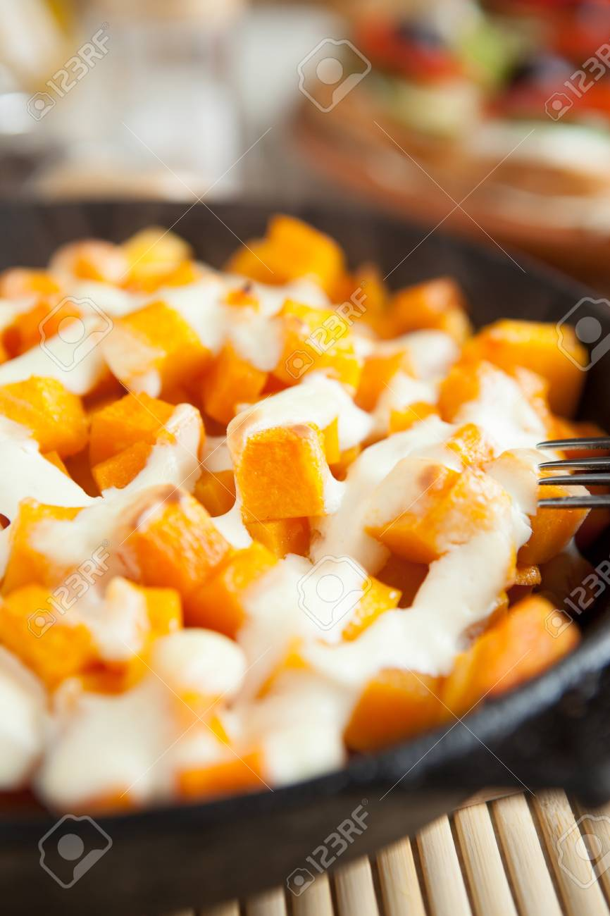Slices of pumpkin and cream cooked in the oven, close up food Stock Photo - 16687901