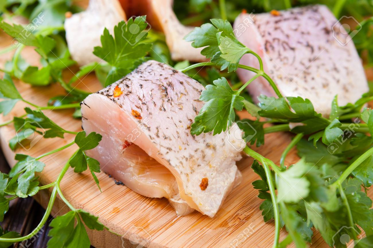 pike fillet pieces on a cutting board, closeup Stock Photo - 19157569