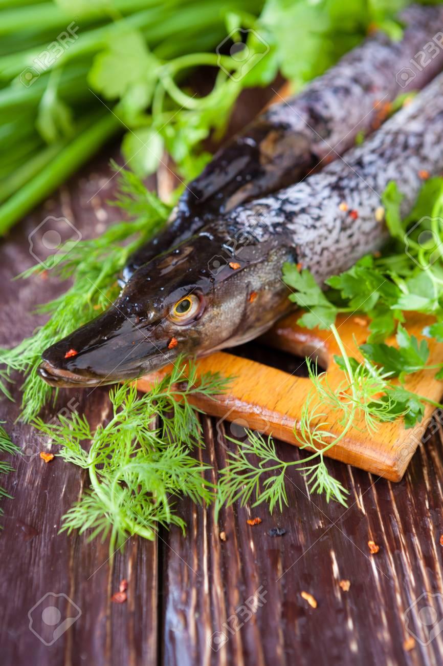 Uncooked fish on board, raw pike, food closeup Stock Photo - 19760834