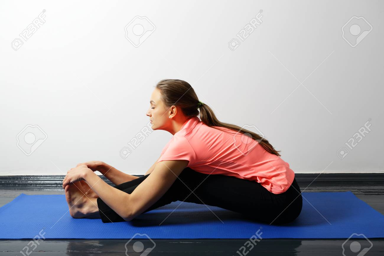 Young woman doing yoga exercises for flexibility
