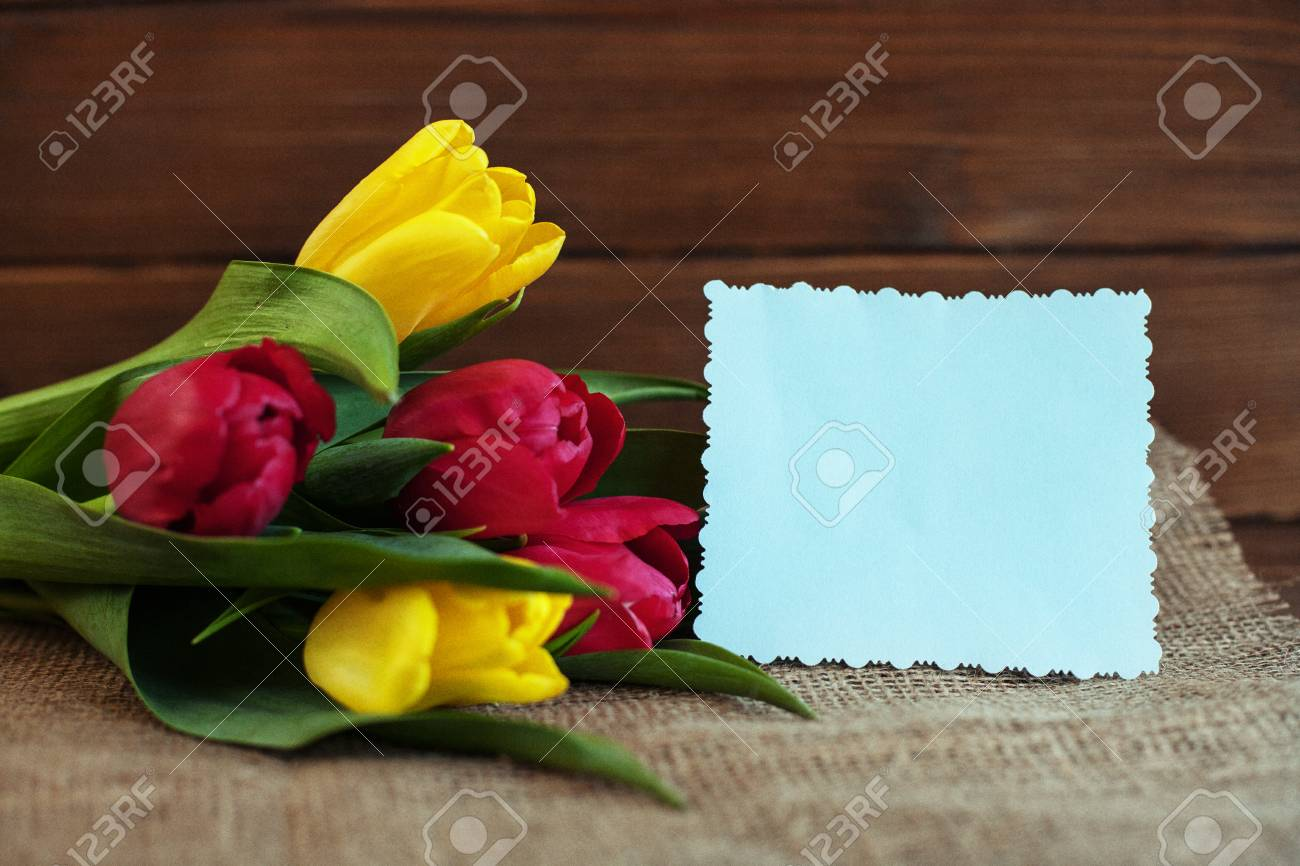 Spring Flowers On A Wooden Background Concept Of Holiday Birthday