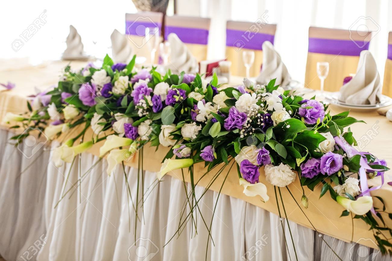 Flower arrangement on the table purple and white flowers the flower arrangement on the table purple and white flowers the concept of a party mightylinksfo