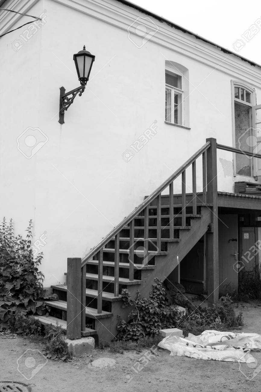 Wooden Stairs Outside The House In Black And White Stock Photo