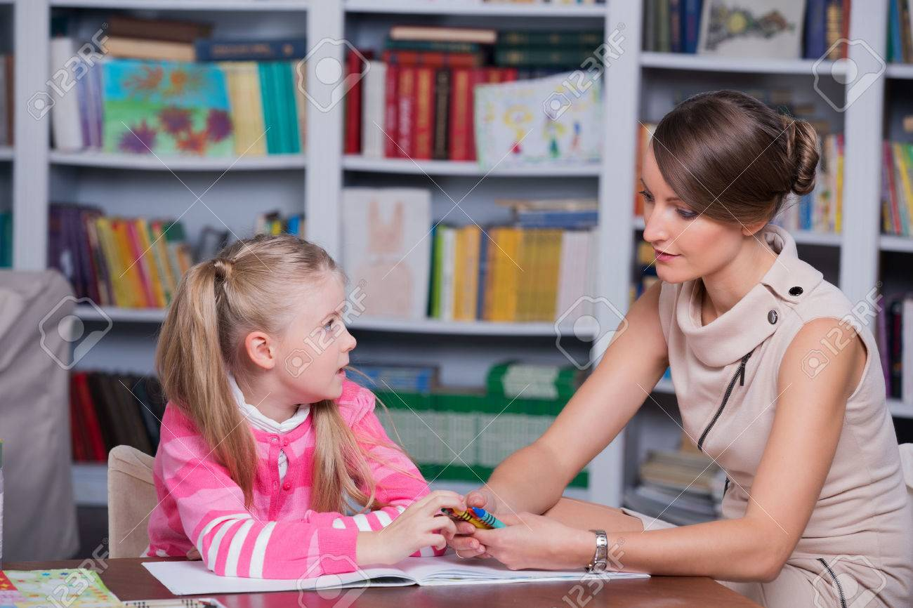 Child Psychologist With A Little Girl, A Child Draws With Colored ...