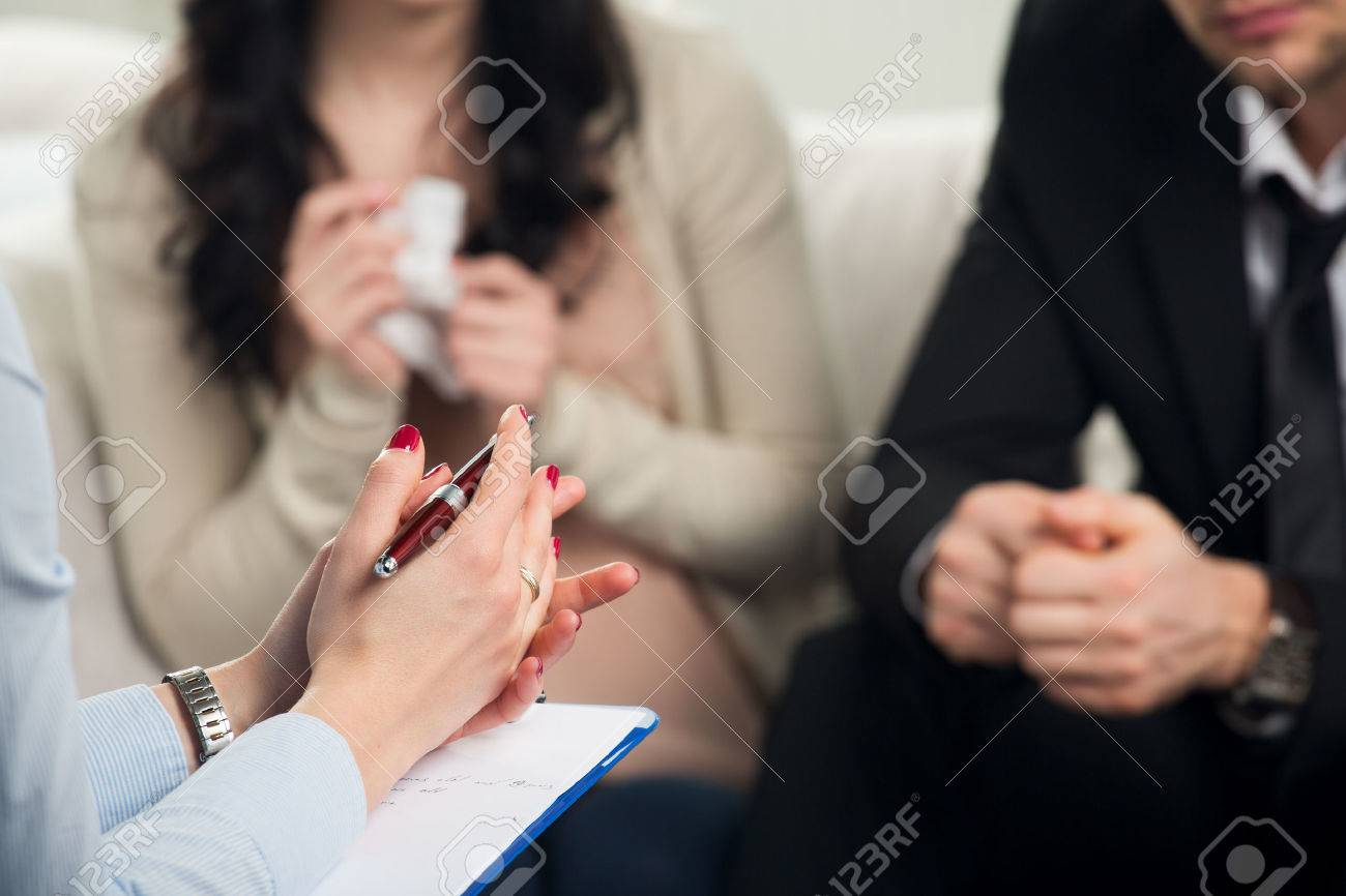 Young couple with a problem to consult a psychologist - 54122727