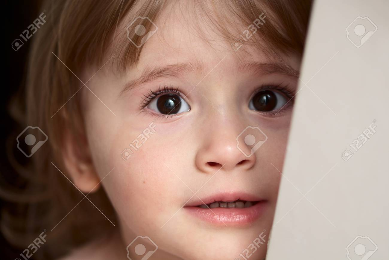 Little girl with eyes full of scare and sadness Stock Photo - 7805682