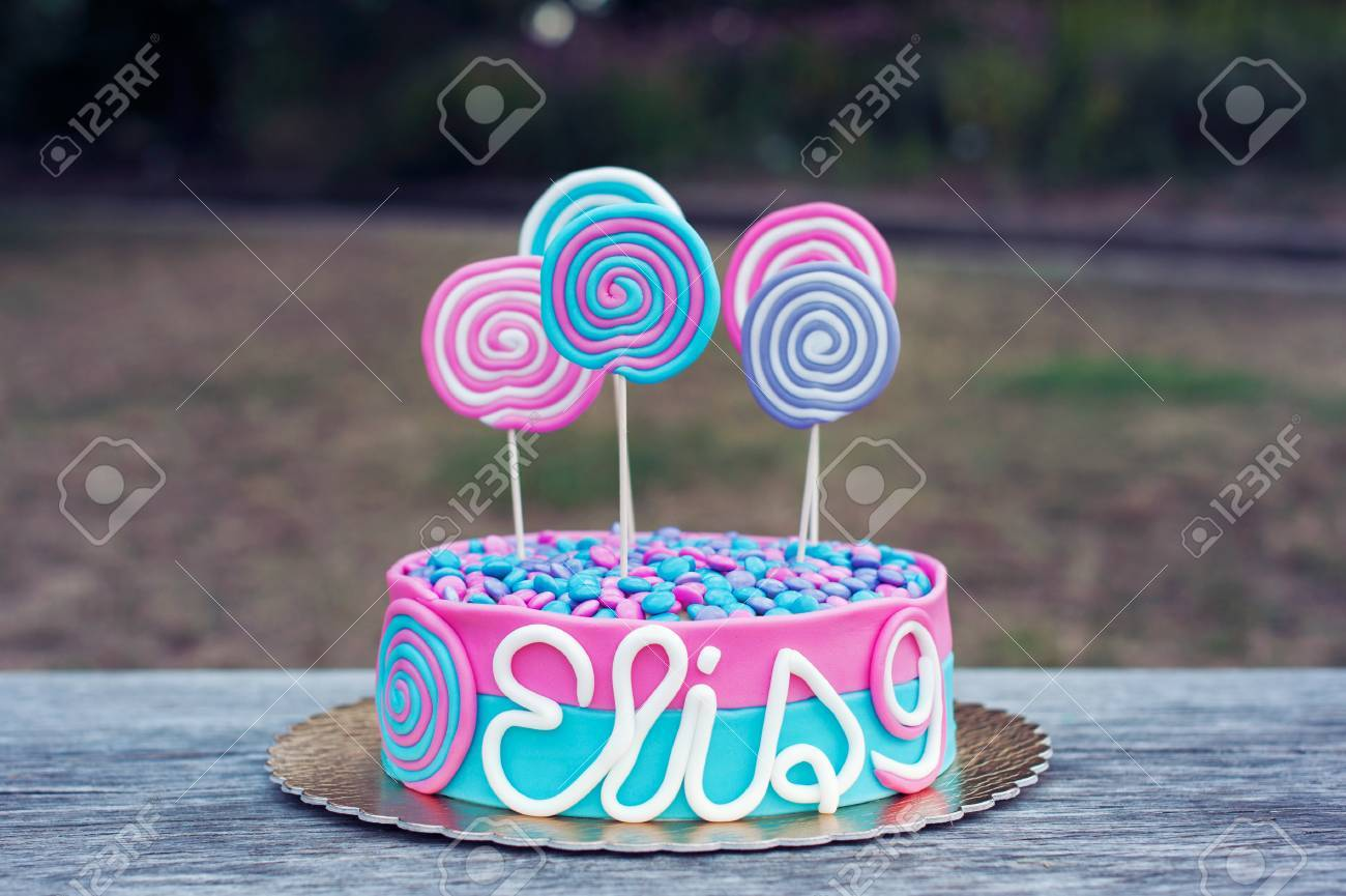 Delicious Birthday Cake On A Table Outdoor Stock Photo