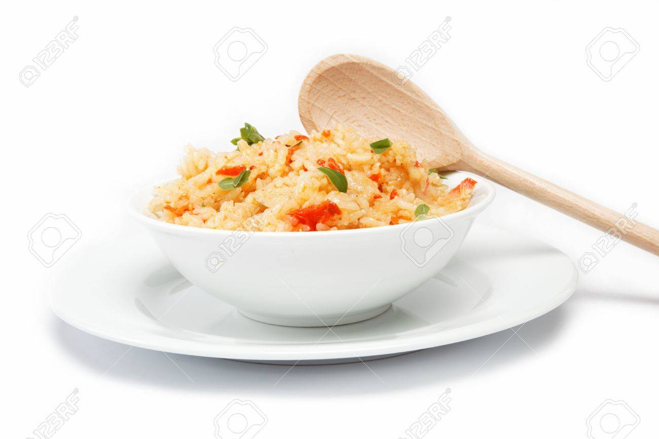 Rice in a bowl on a white background. - 14860123