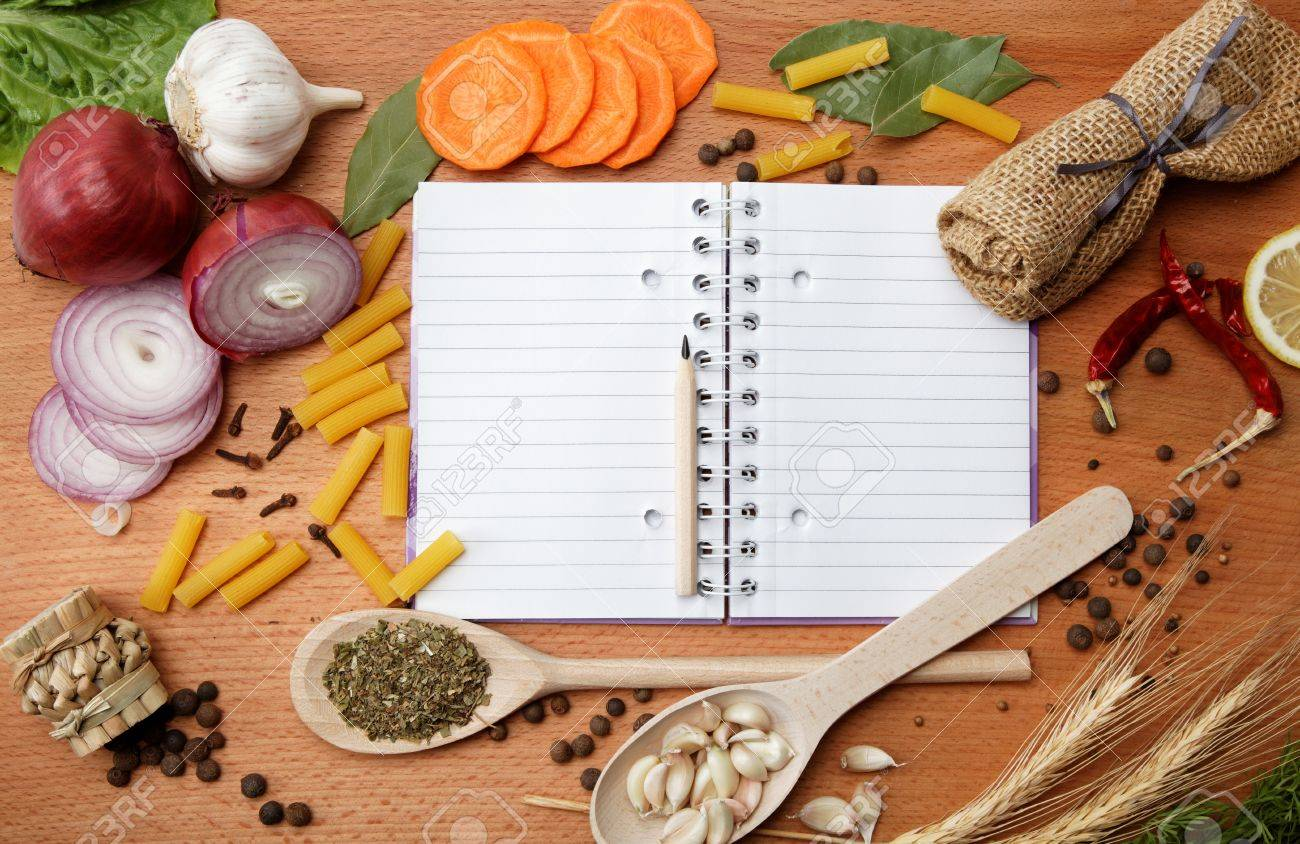 notebook for recipes and spices on wooden table - 15092411