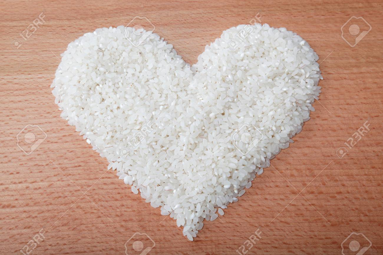 Heart of rice laid on a wooden table. - 15167577