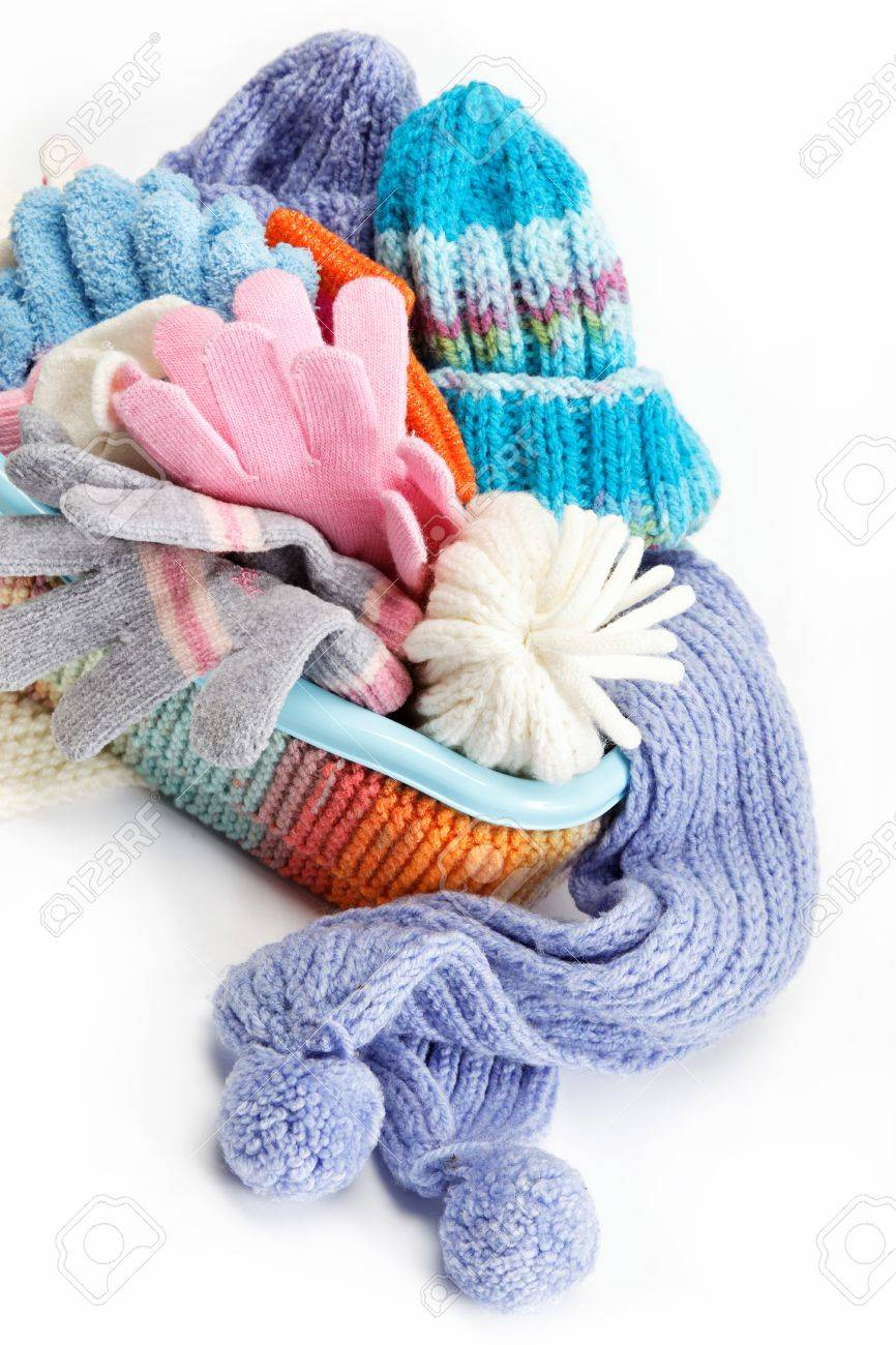 Winter accessory collection. Hat, scarf and mittens in the container, isolated on white background. - 15908610