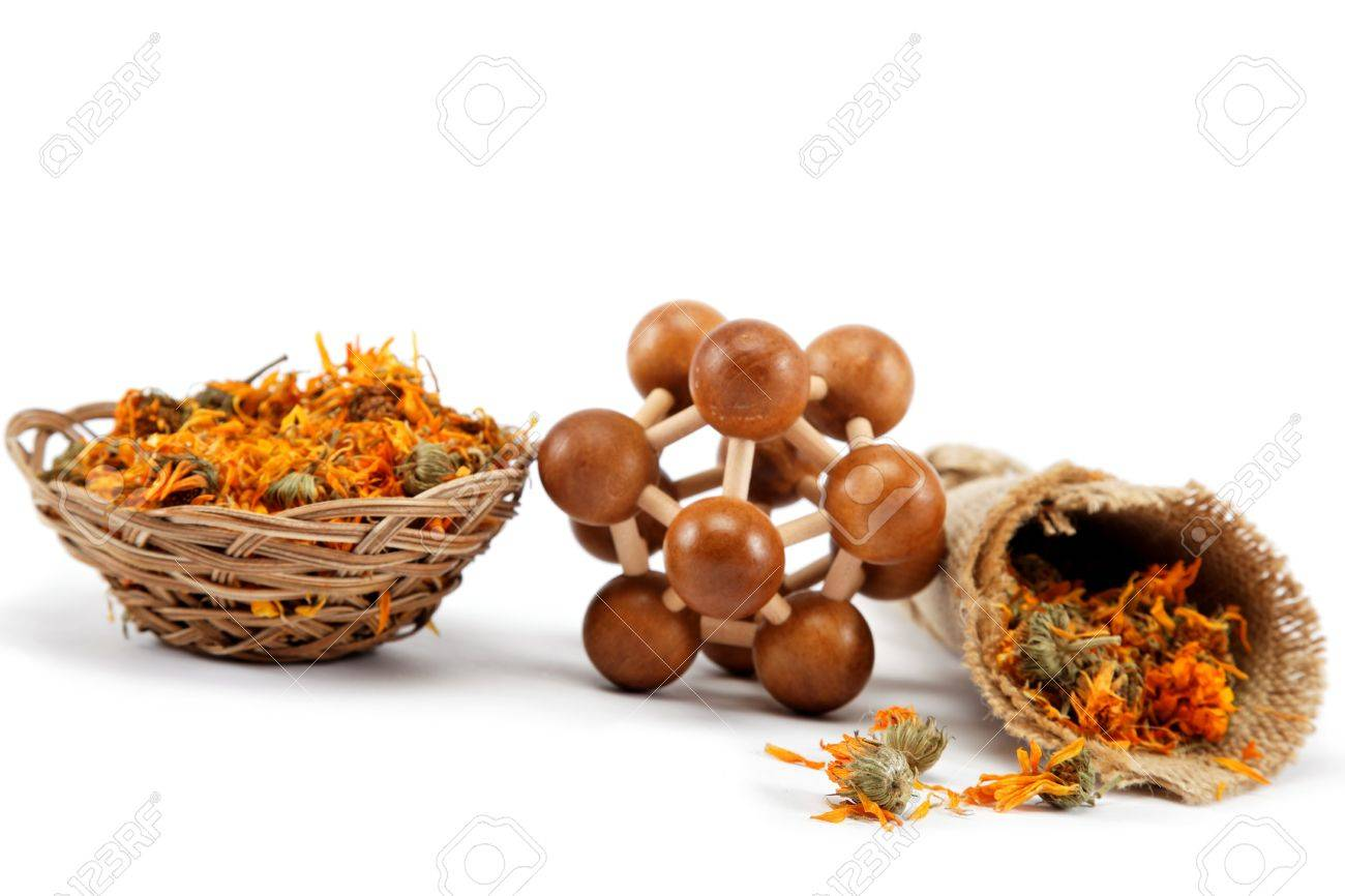 Herbs. Dried calendula or pot marigold flowers isolated on white background. Stock Photo - 16236797