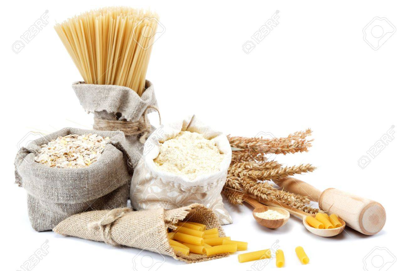 Flour, cereals, pasta in a canvas bag and ear on white background. - 17825484