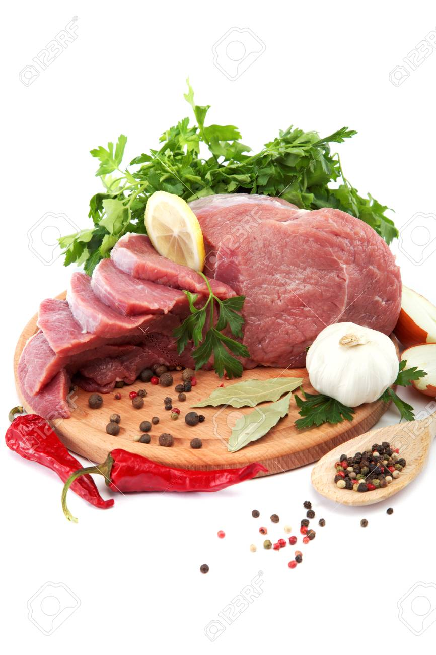 Raw meat, vegetables and spices on a wooden cutting board isolated on white background. Stock Photo - 17944011