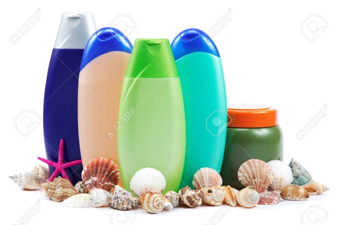 Different color tubes and bottles for hygiene, health and beauty on a white background. - 18975636