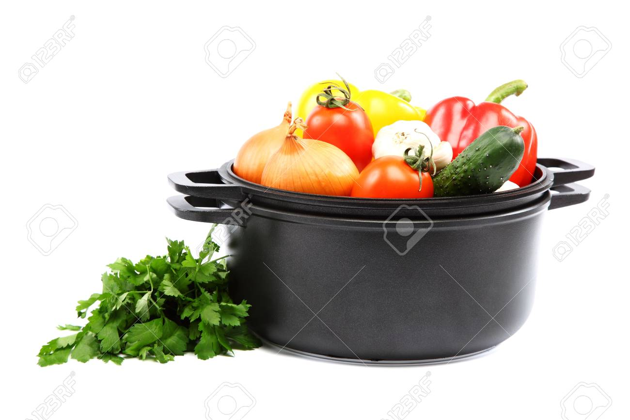 Healthy food. Fresh vegetables in black saucepan on a white background. - 20169763
