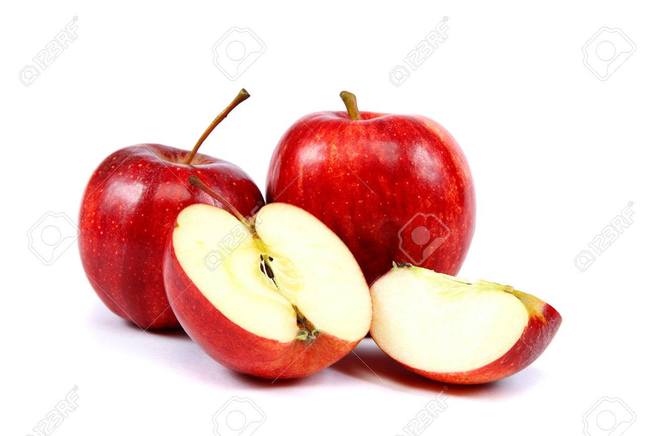 Fresh red apples with a slice isolated on white . - 24091061