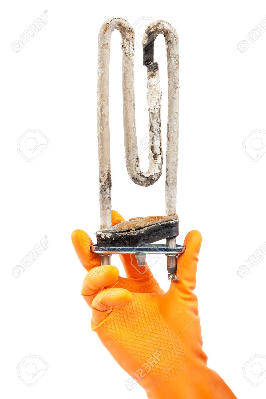 Damaged heating element of the washing machine in hand with rubber gloves isolated on white background. - 36315582