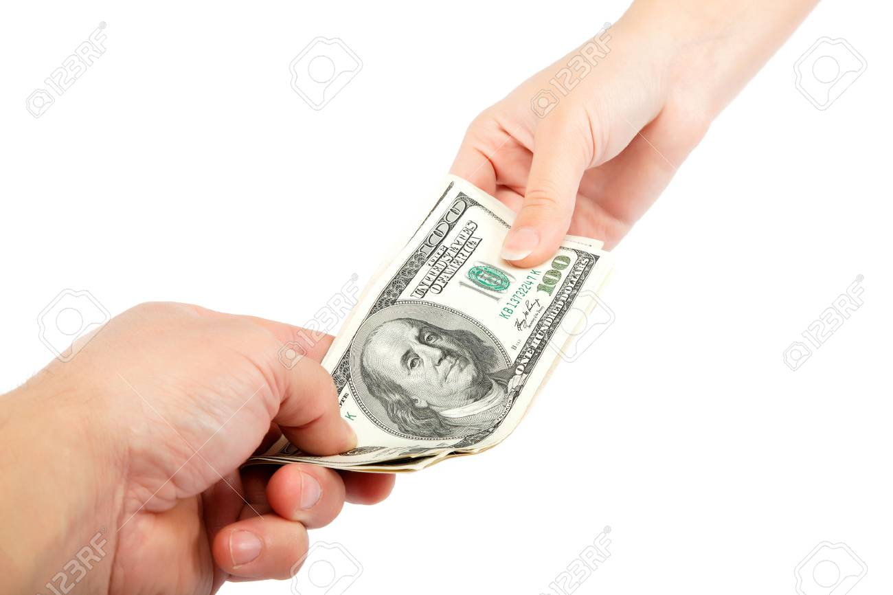 Transferring of money from hand to hand is isolated on a white background. - 42490275