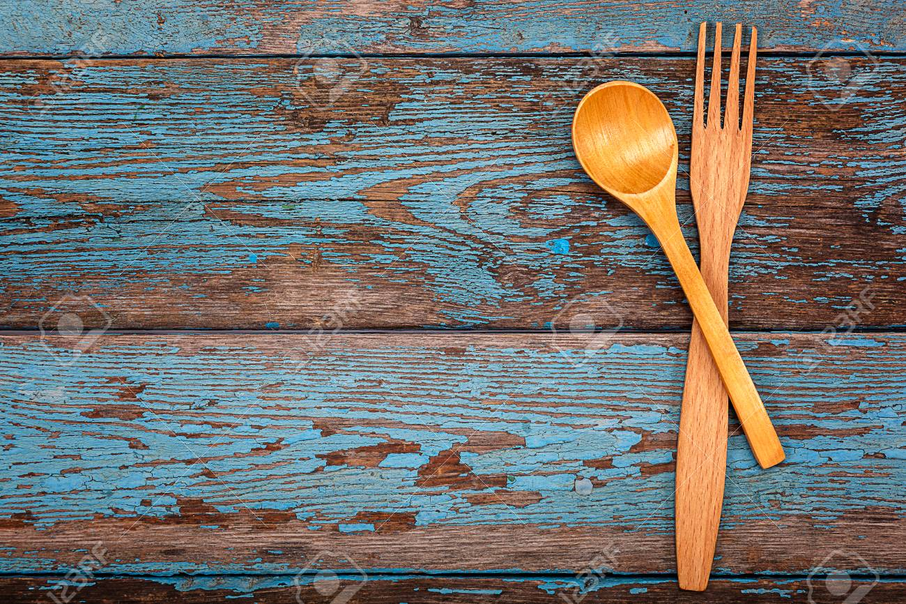 Spoon And Fork. Set Kitchen Utensils On A Wooden Background... Stock ...