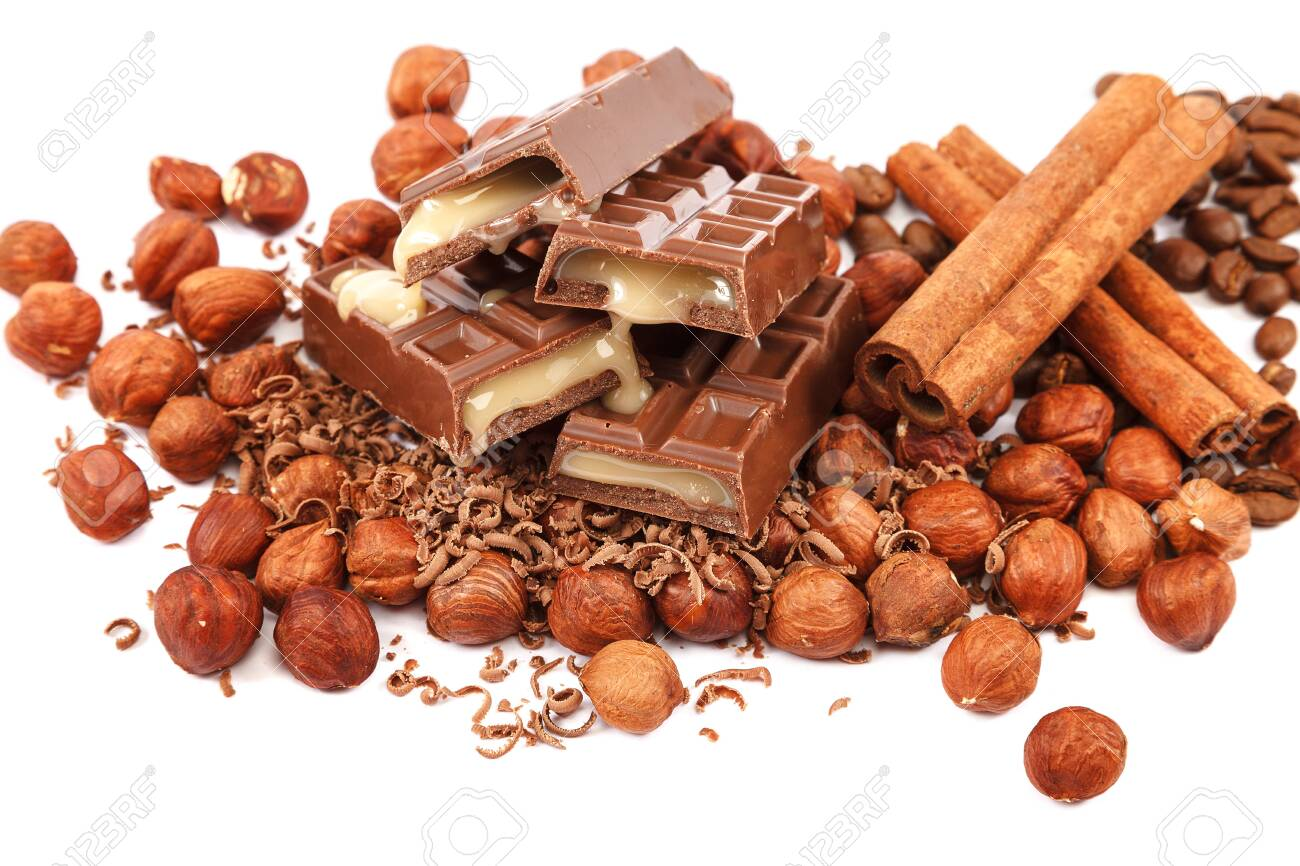 Chocolate tiles and nuts isolated on white background. - 144898393